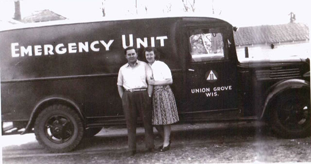 Dr. T.H. Wooley and his wife standing next to the first Union Grove rescue squad.